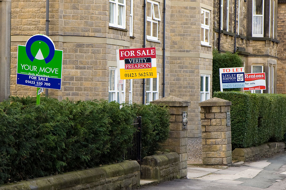 Houses with for sale signs