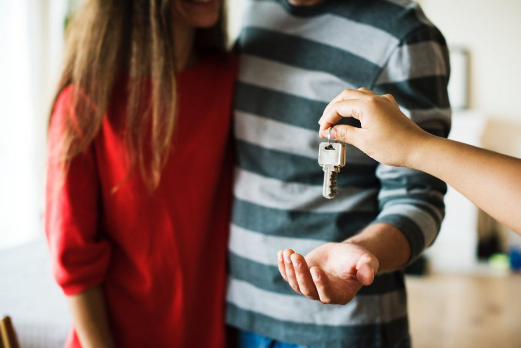 Couple getting keys to new home