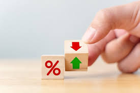 Hand with wooden blocks showing low mortgage rates